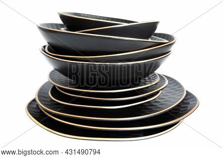 Stack Of Stylish Modern Dinner Plates. Set Of Ceramic Tableware Isolated On White Background. Plates