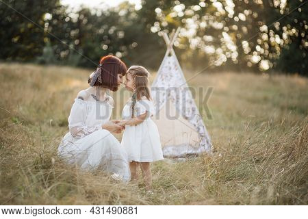 Family, Emotions, Mothers Day Concept - Sensual Caring Lovely Young Mom Cuddles With Her Cute Adorab