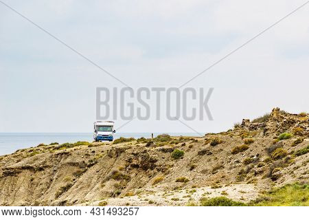 Camper Car Camping On Cliff, Spanish Landscape Along Almeria Coast. Traveling With Motorhome.