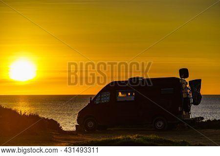 Camper Van Recreational Vehicle At Sunrise On Mediterranean Coast In Spain. Camping On Nature Beach.
