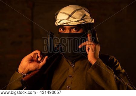 Terrorist Or Gangster With Face Cover Blackmailing Or Asking For Ransom Over Mobile Phone Call And W
