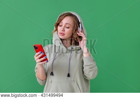 Happy Teeth Smile Woman Listen Music Headphones Holding Smartphone In Hand Looking Screen Caucasian