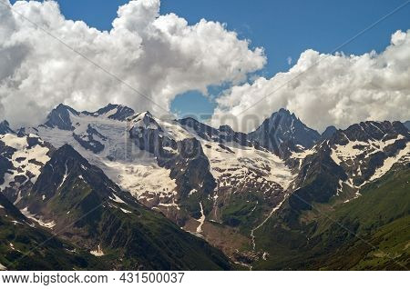 Beautiful Mountain Landscape Of The Caucasus Mountain Range. Mountain Peaks And Clouds At Summer.