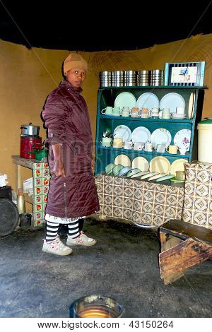 Lesotho women inside of the traditional house at Sani Pass