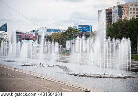 Waterfront Fountains, Urban Architecture In Summer Daytime