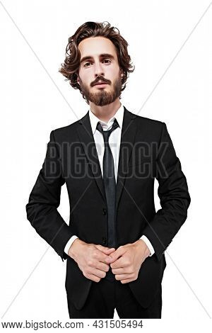 Portrait of a handsome well-groomed man posing in classical black suit and white shirt. Studio shot on a white background. Fashion concept.