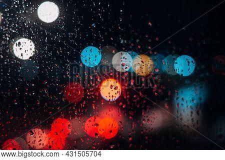 Bokeh Rainy Night City Defocus, Raindrops On The Window. Abstract Background Night City Life