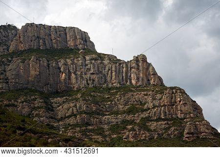 Montserrat Is A Mountain Near Barcelona, In Catalonia. It Is The Site Of A Benedictine Abbey, Santa