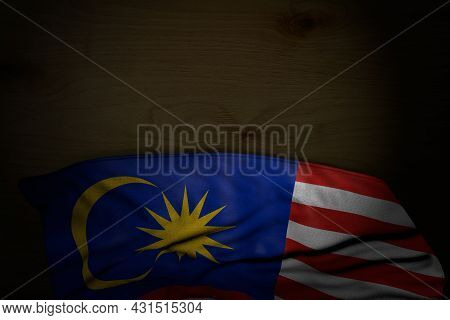 Cute Dark Photo Of Malaysia Flag With Large Folds On Dark Wood With Free Place For Text - Any Feast