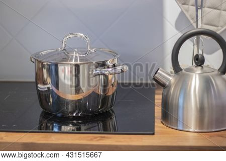 Metal Kettle On A Stove. Kettle Boiling On A Gas Stove. Kitchen Countertop. Kitchen Sink, Hob, Stove
