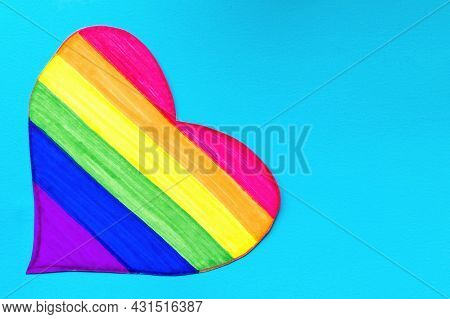 Close Up Of Heart Decorated In The Colors Of The Lgbt Flag On A Bright Blue Monochrome Background Wi
