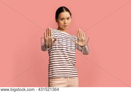 Refusal. Portrait Of Unpleased Asian Lady Showing Stop Gesture With Two Hands