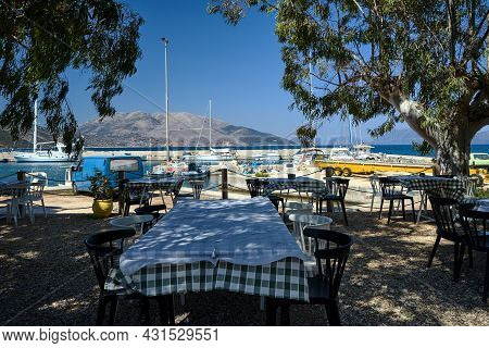 Tavern Tables In The Port Of Sami On The Island Of Kefalonia In Greece