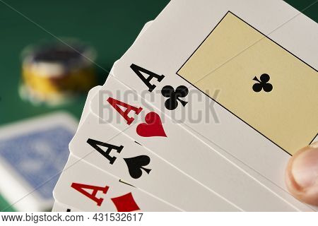 Cards With Poker Of Aces In The Background Are Seen Casino Chips On Green Table