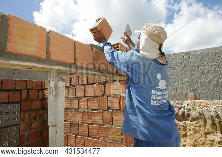 Mason In Construction Of Low-income Houses