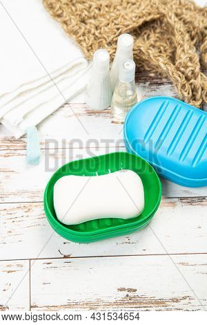 Several Plastic Soap Dishes And Soap, On A Wooden Table. Cleanliness Concept