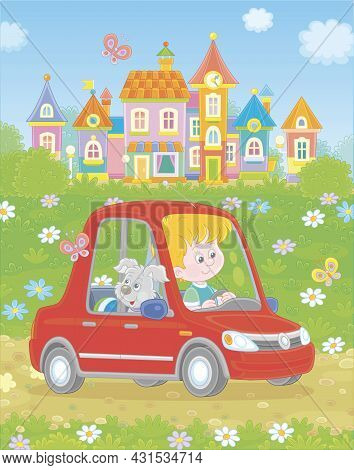 Smiling Little Boy With His Cheerful Pup Driving A Red Toy Car On A Road Out Of A Pretty Small Town