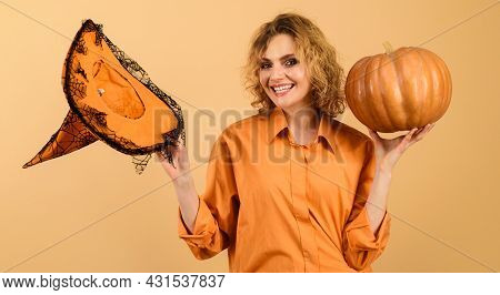 Smiling Halloween Witch With Pumpkin. Happy Girl With Magic Witches Hat. Trick Or Treat. Halloween T