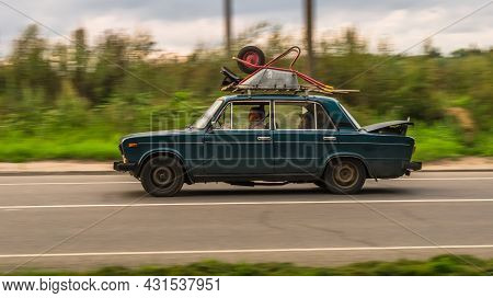 Moscow, Russia - August 2021: Old Car Lada 2106 Rides On A Rural Highway. Green Vintage Sedan Motor