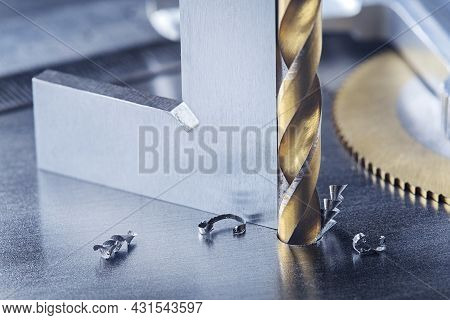 Metal Drill Bit With Triangle Ruler Make Holes In Steel Billet On Industrial Drilling Machine. Metal