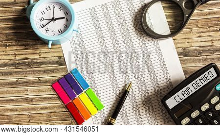 Calculator With Text Claim Rejected On Documents With Clock, Magnifying Glass And Stickers. Business