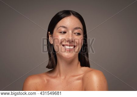 Beautiful Natural Girl With Toothy Smile And Freckles. Portrait Of Beauty Young Woman With Nude Shou