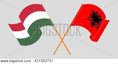 Crossed And Waving Flags Of Albania And Hungary