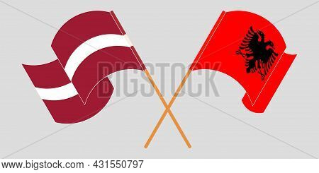 Crossed And Waving Flags Of Albania And Latvia