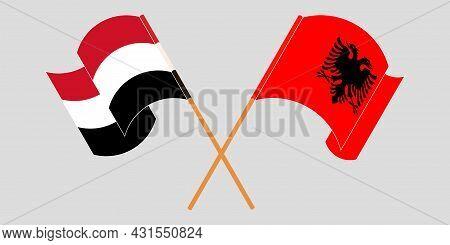 Crossed And Waving Flags Of Albania And Yemen