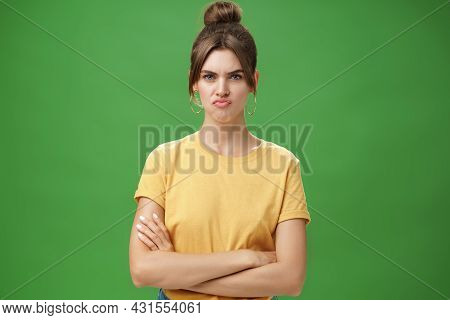 Girl Not Liking Result Of Work Looking Displeased And Serious At Camera, Frowning Crossing Hands Aga