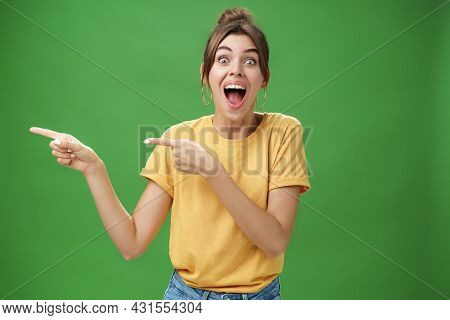 Waist-up Shot Of Enthusiastic And Charismatic Impressed Happy Girl Laughing And Smiling Broadly Poin