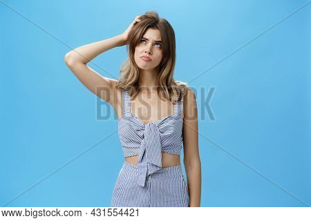 Silly Confused Charming Adult Female With Chestnut Hair In Trendy Outfit Sulking Looking Questioned