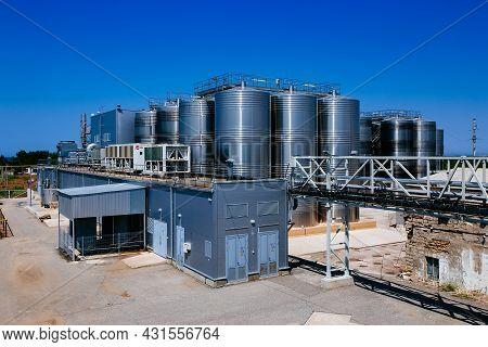 Modern Winery. Stainless Steel Barrels For Wine Fermentation