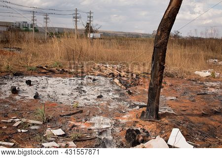 Remains Of A Brush Fire At An Illegal Trash Dump In Granja Do Torto, North Of Brasilia, Brazil
