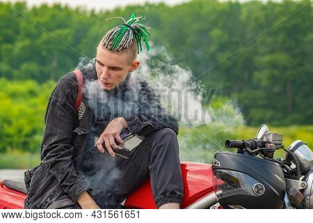A Guy, A Teenager, A Man Of Non Standard Informal Appearance With Pigtails On His Head, Dreadlocks A