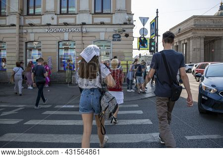 St. Petersburg, Russia - July 09, 2021: People Turn The Road To Nevsky Prospect In St. Petersburg