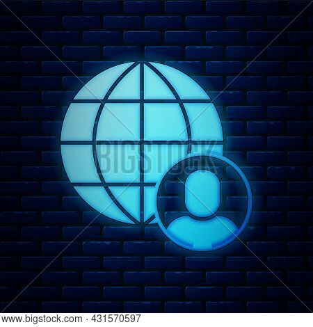 Glowing Neon Freelancer Icon Isolated On Brick Wall Background. Freelancer Man Working On Laptop At