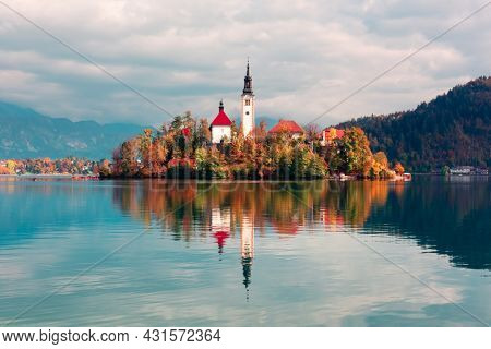 Colorful autumn view of Bled lake in Julian Alps, Slovenia. Pilgrimage church of the Assumption of Maria on a foreground. Landscape photography