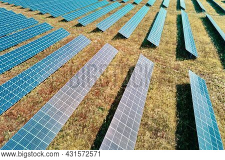Row Of Solar Panels In The Field. Solar Battery Farm, Aerial View. Alternative Renewable Energy Conc