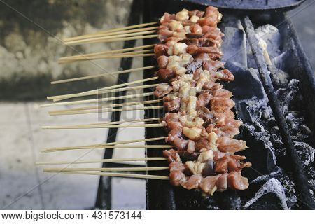 Sate Kambing Or Goat Satay On Red Fire Grilling By People.