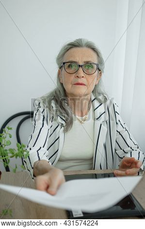 Senior Grey Haired Businesswoman In Striped Jacket With Eyeglasses Is Working With Documents In Here