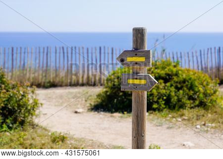 Yellow Sign Arrow Markings For Walking Path Hiking Trails Pathway In Nature Beach Coast