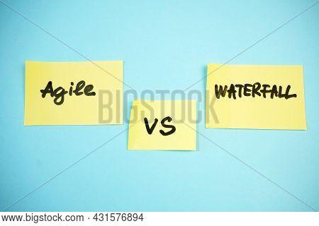 Waterfall Vs Agile Paper Task On Blue Background, Software Development Methodologies Concept, Closeu