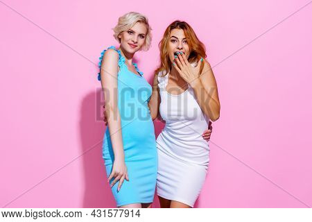 Two Stunning Beautiful Confident Lady Chic Hugging Wearing Pretty Nice Cute Dresses Isolated On Pink