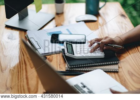 Close Up Bookkeeper Or Financial Inspector Hands Making Report, Calculating. Home Finances, Investme