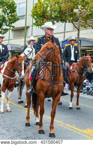 SAN FRANCISCO, USA - OCTOBER 11, 2009: Columbus Day celebration. Equestrian parade in honor of the national holiday. Dressy riders in cowboy hats riding on well-groomed horses.