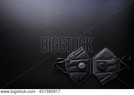 Two Protective Black Respirators With Valve And Filter Lie On Dark Gradient Background. Kn95 Protect