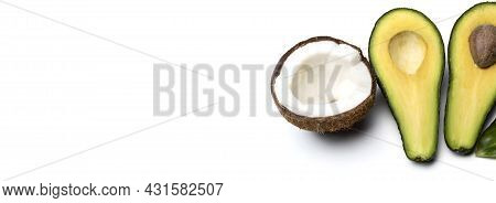Isolated Fruits. Half Avocado And Half Coconut. Isolated On White Background With Clipping Path. Cop