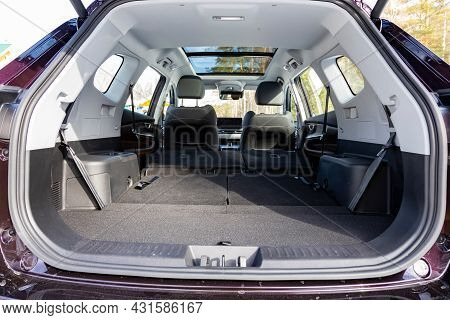 A Huge Car Interior With The Rear Seats Folded Down. Large Luggage Compartment Of A Family Car. Car