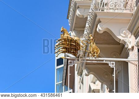 Baden-baden, Germany - July 2021: Golden Sculpture Of Chariot Carriage With Four Horses On Facade Of